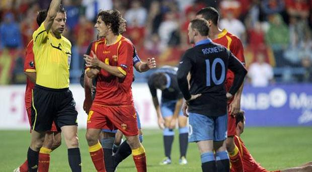 Wayne Rooney was shown a straight red against Montenegro