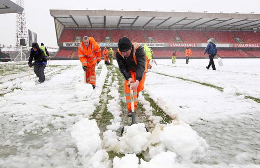 Despite the best efforts of IFA staff and supporters the Windsor Park pitch was unplayable