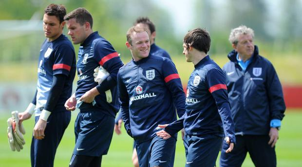 England's Wayne Rooney talks to Leighton Baynes during a training session at St George's Park, Burton Upon Trent