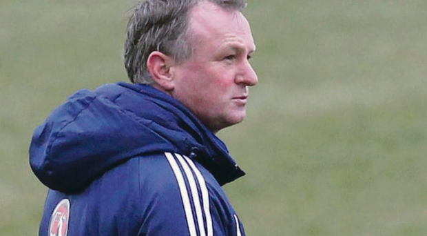 A world apart: Michael O'Neill (pictured) and Fabio Capello have taken different routes to their meeting at Windsor Park
