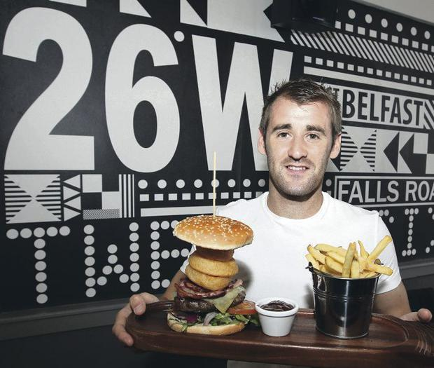 Northern Ireland and Aberbeen player, Niall McGinn takes a break from training for the forthcoming World Cup qualifier against Russia to enjoy a meal at 26 West, a new restaurant in Belfast that he co-owns
