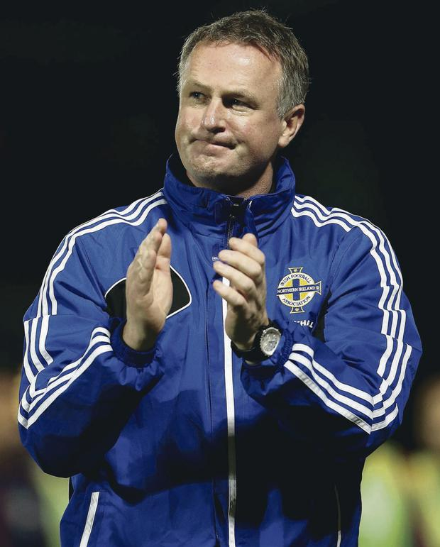 Northern Ireland manager Michael O'Neill celebrates after defeating Russia in Wednesdays 2014 FIFA World Cup Qualifier at Windsor Park