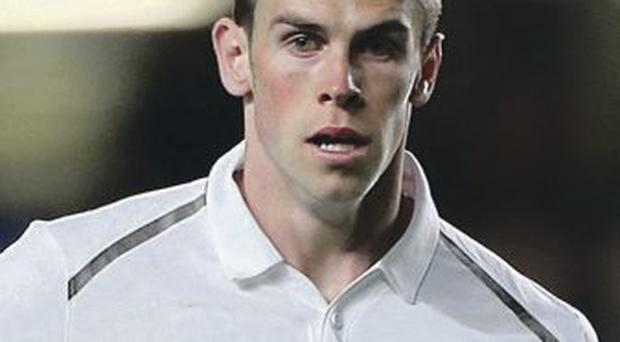 Goal-den boy: Gareth Bale has been targeted by Real Madrid