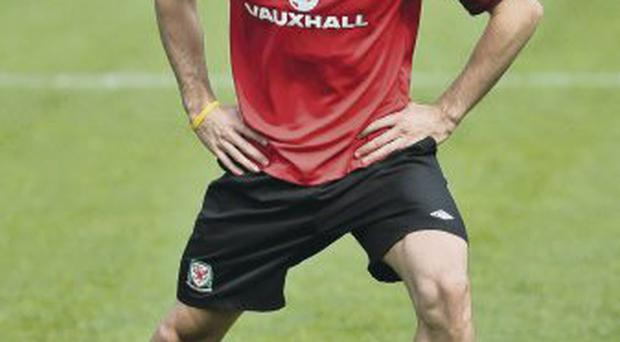Test: Gareth Bale stretches his injured groin during training