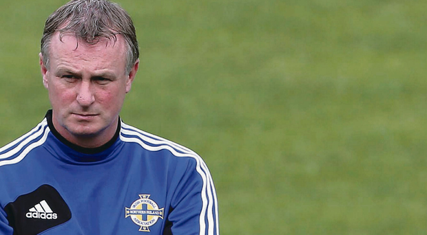 Determined mood: Northern Ireland manager Michael O'Neill watches training from the sidelines in Luxembourg