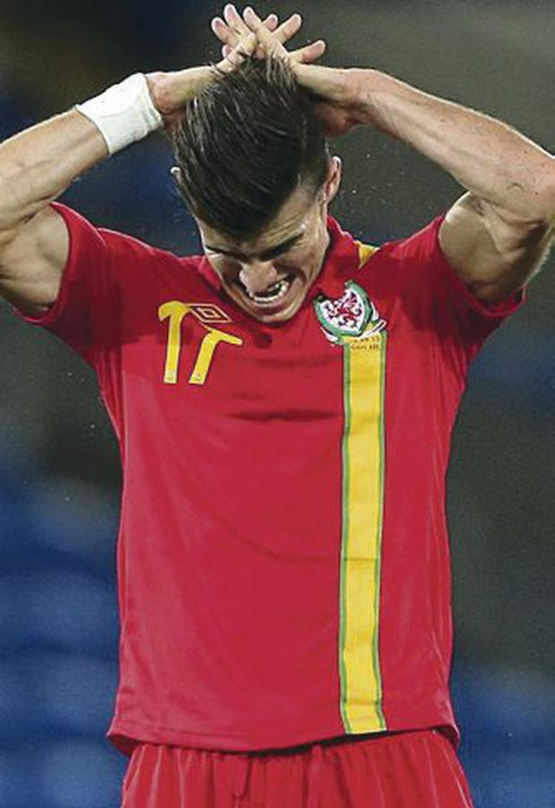 A frustrated Bale after missing a free-kick last night