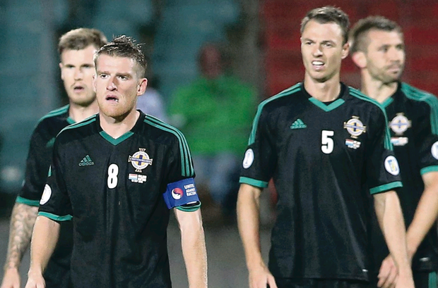 Shocked: Northern Ireland skipper Steven Davis and defender Jonny Evans can't hide their disgust after crashing to defeat in Luxembourg