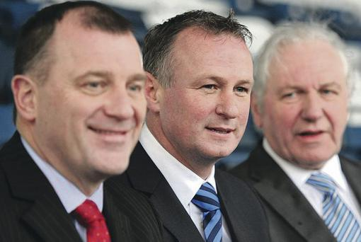 Middle man: Michael O'Neill (centre) has Jim Shaw's backing (right)