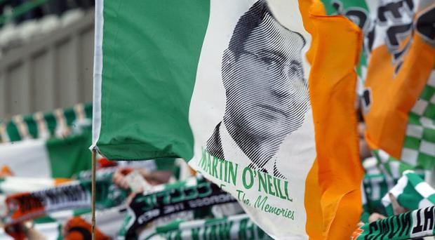 Fans fly an Irish tricolour showing Martin O'Neill's face at Jackie McNamara's testimonial between Celtic and the Republic of Ireland 29/5/2005
