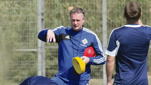 Good to talk: Michael O'Neill takes the Northern Ireland training session in Tel Aviv yesterday ahead of tomorrow's game against Israel