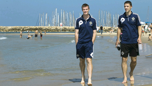 Life's a beach: Northern Ireland players Chris Brunt and Chris Baird take a walk on the beach in Tel Aviv ahead of tonight's match against Israel