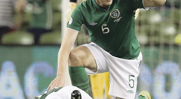 Huge blow: John O'Shea shows his concern as Darron Gibson sustains a bad knee injury at the Aviva Stadium