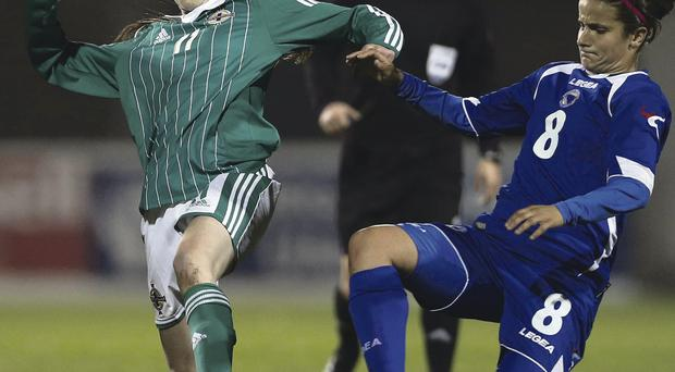 Northern Ireland's Aimee Mackin is tackled by Aida Hadzic