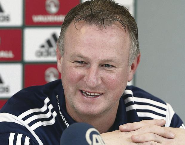 All smiles: Michael O'Neill has a new two year deal but he knows results will have to improve