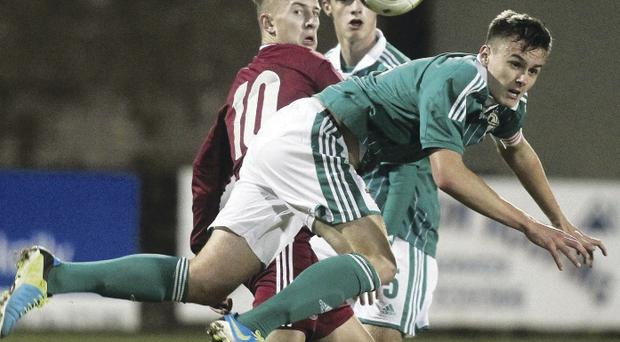 Tough battle: Northern Ireland's Scot Whiteside with Latvia's Devids Dobrecovs in action last night