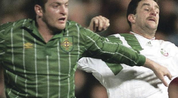 Stuck in: Northern Ireland's Gerry Taggart comes up against John Aldridge of the Republic