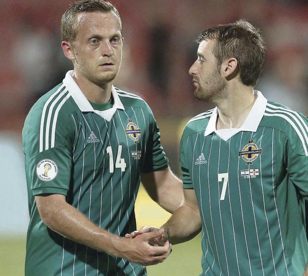 Experienced man: Sammy Clingan (left) hopes his performances will keep him in the Northern Ireland set-up