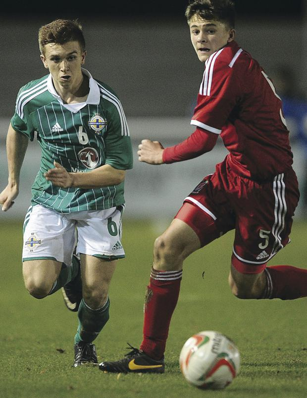 In battle: Northern Ireland's Matthew Henry has his eyes on the ball