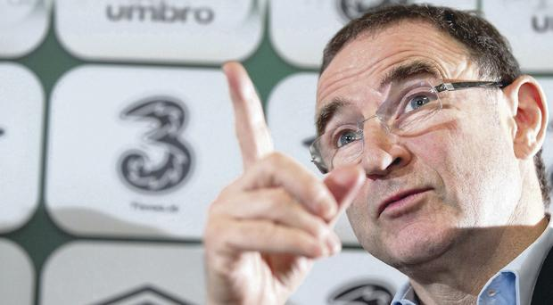 Talking tactics: Martin O'Neill makes his point at yesterday's press conference