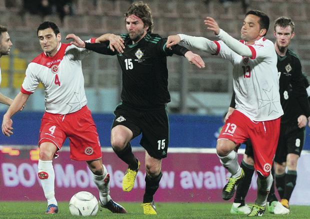Surging run: Paddy McCourt takes on Malta last February