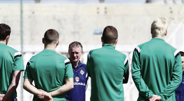 Michael O'Neill discusses tactics with his Northern Ireland squad ahead of tonight's game