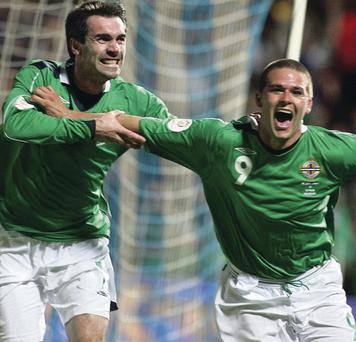 Put to the sword: David Healy is jubilant after scoring against Spain in the memorable 2006 success at Windsor Park