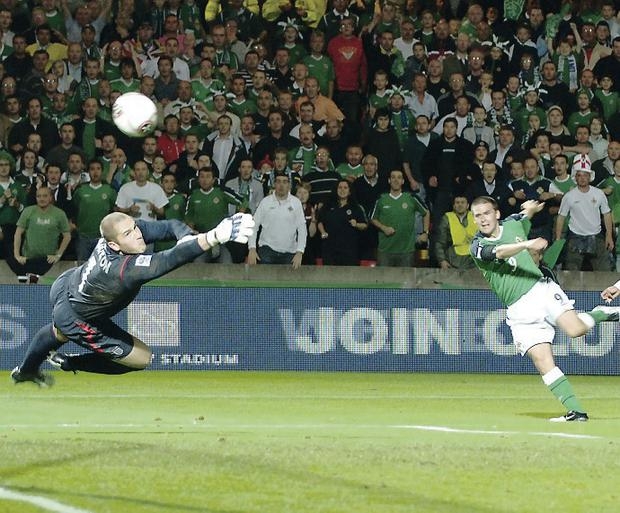 Golden moment: David Healy slams home the winner for Northern Ireland against England in 2005 at Windsor Park