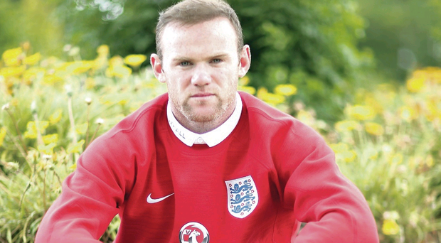 Making plans: Wayne Rooney relaxes at the Vale Do Lobo Resort during the week