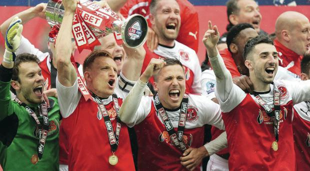 Simply the best: Conor McLaughlin (right) celebrates Fleetwood Town's play-off victory, before joining the Northern Ireland squad