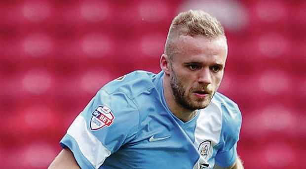 Committed: Ryan McLaughlin trains with the Northern Ireland squad yesterday