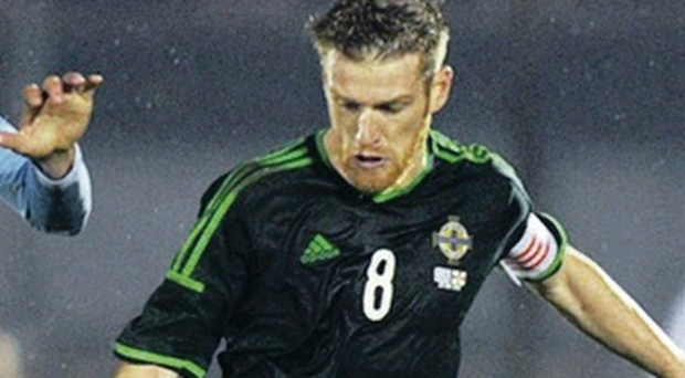 On the ball: Steven Davis says Chile are nothing to fear