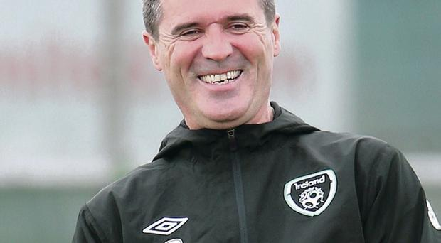 Club call: Roy Keane was all smiles during training at Malahide yesterday after confirming he won't be quitting the Republic side