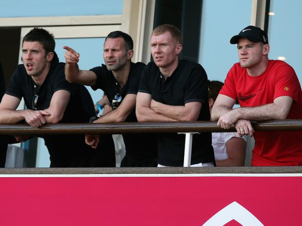 Not united: Michael Carrick, Ryan Giggs, Paul Scholes and Wayne Rooney were all singing from the same hymnsheet at Manchester United but now Scholes and Rooney aren't seeing eye to eye on the England front