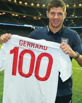 Getting shirty: Steven Gerrard poses as he wins the 100th of his eventual 114 caps for England