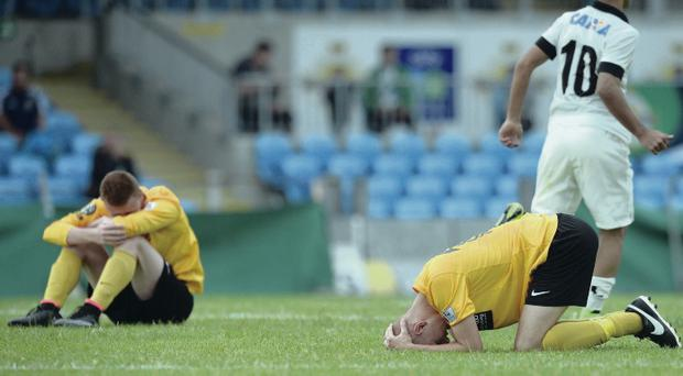 Gutted: County Antrim players are clearly dejected after their Junior final defeat against Corinthians