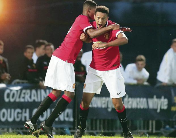Winning strike: Cameron Borthwick-Jackson is congratulated after scoring what turned out to be Manchester United's winner