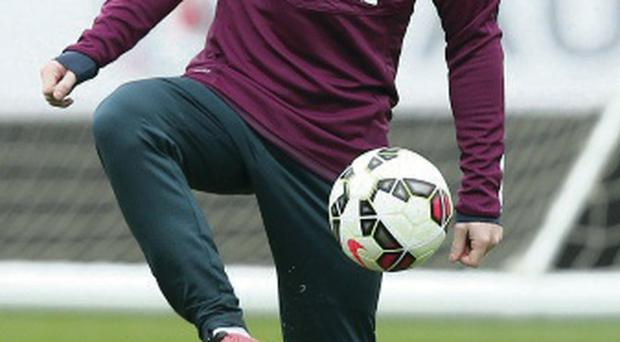 Raring to go: Captain Wayne Rooney steps up preparations for next week's opening Euro 2016 qualifier