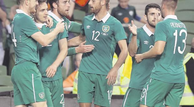 Off and running: Republic players celebrate after Kevin Doyle (second from left) had opened the scoring