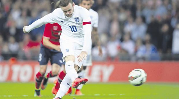 Spot on:Wayne Rooney strokes home his penalty for the only goal of the game at Wembley last night