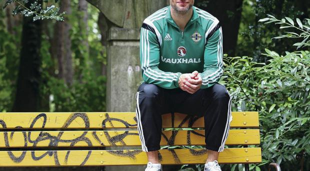 On the bench: Aaron Hughes will hope Michael O'Neill won't leave him sitting on the sidelines against Hungary tomorrow