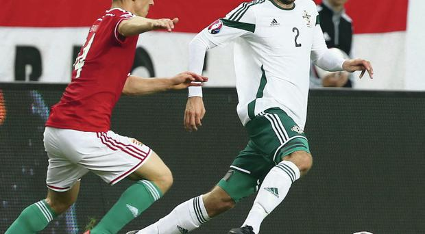 Tight tussle: Hungary's Adam Lang and Conor McLaughlin