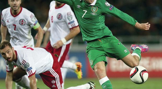 Get in: Aiden McGeady fires home Ireland's last-minute winner against Georgia. His team-mates have hailed the winger's star class