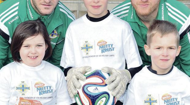 Nuts about football: Young players from the IFA's Nutty Krust Holiday Camps team up with Northern Ireland stars Martin Paterson and Sammy Clingan