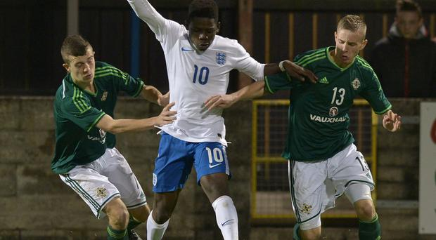 Double team: Northern Ireland's Chripstopher Crane and Tre Sterling do their best to stop England's Ayotomiwa Bashiru
