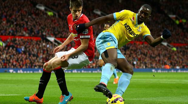 Pitch perfect: Paddy McNair keeps a close eye on Crystal Palace's Yannick Bolasie at Old Trafford
