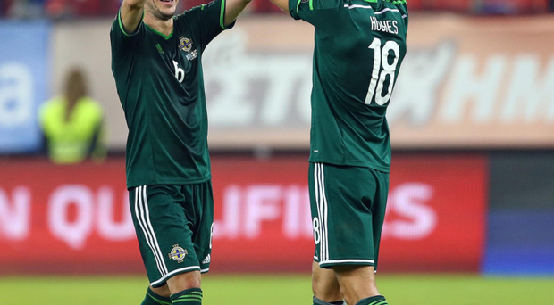 Cashing in: Chris Baird and Aaron Hughes hope Northern Ireland will keep counting their blessings