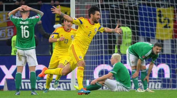 Deadlock broken: Romania's Paul Papp celebrates after scoring the first goal in their win over Northern Ireland