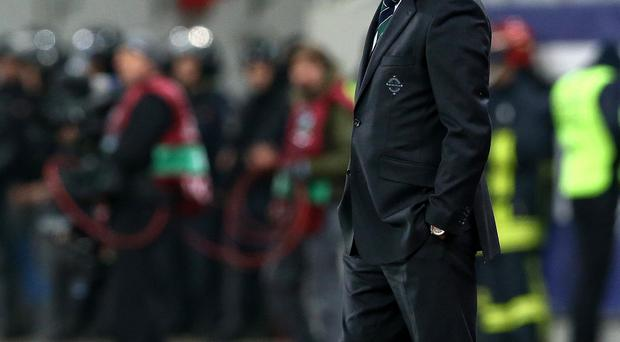 Head down: Michael O'Neill's disappointment is clear to see during Northern Ireland's defeat