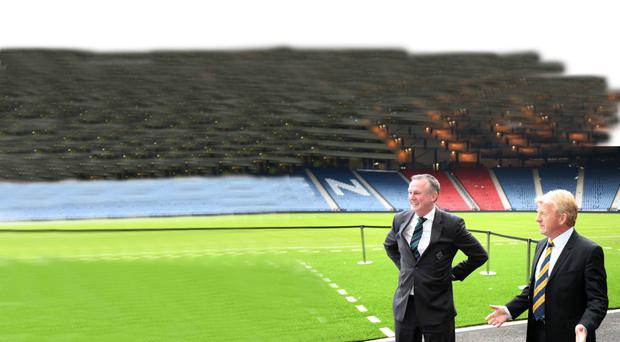 Pitching up: Michael O'Neill and Gordon Strachan have a chat at Hampden yesterday