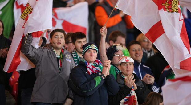 In fine voice: Northern Ireland supporters get behind the team at Hampden Park last night